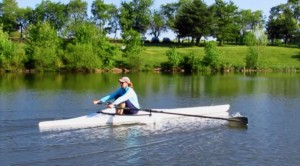 Adult sculler rowing new training single